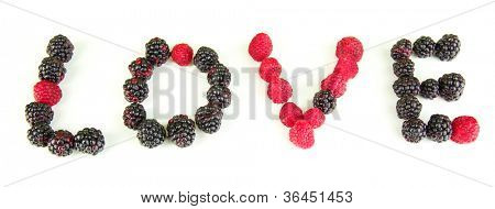 Word Love of raspberries and brambles close-up isolated on white