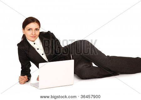 A young girl with a laptop lying on the floor, isolated on white background