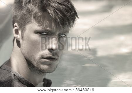 Portrait of a handsome young man against modern background with copy space
