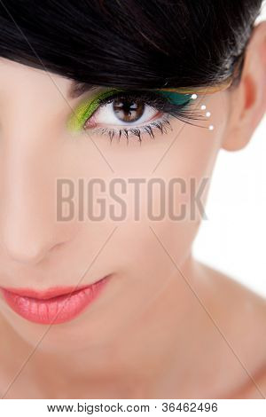 Close-up of a happy beautiful young woman looking at camera. young woman model with excentric make-up smiling.