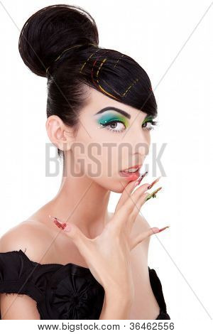 Young woman model with excentric makeup and nails touching her chin . Over white background