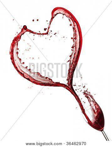 Heart symbol splashing out of glass, isolated on white background