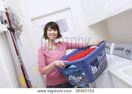 Asian woman carrying laundry basket