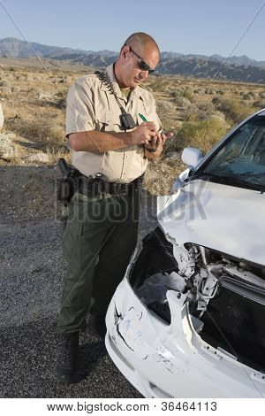 Middle aged traffic cop writing ticket