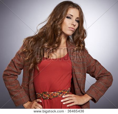 Beautiful high fashion model in autumn clothes posing