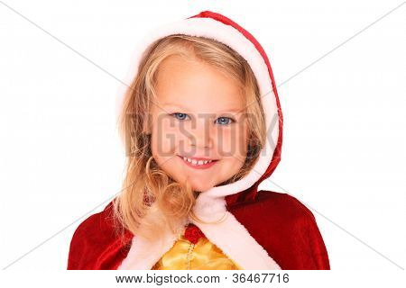 A portrait of a sweet little girl in Santa's cape smiling over white background