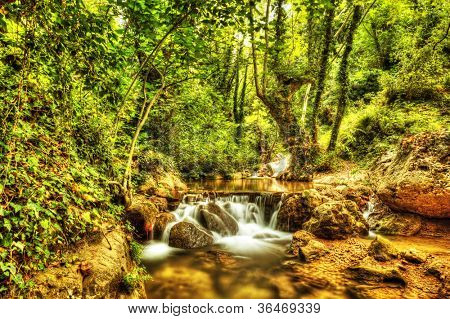 Beautiful waterfall in forest, wonderful view of cascade river, peaceful jungle mountains, wild nature landscape, fresh green trees, water stream in rainforest, freshness and wilderness concept
