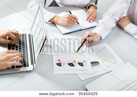 Close-up of Business people discussing a financial plan