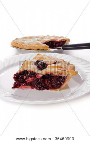 Slice of cherry pie on a white plate with the remainder of the pie in the background over a white background
