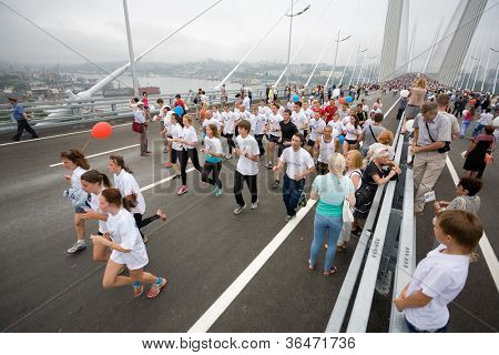 VLADIVOSTOK, RUSSIA - AUGUST 11: People celebrate the opening of the largest cable bridge across the Zolotoy Rog (Golden Horn) August 11, 2012 in Vladivostok, Russia. Bridge Gold length of 1388 m.