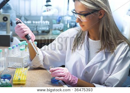 beautiful woman working in modern laboratory