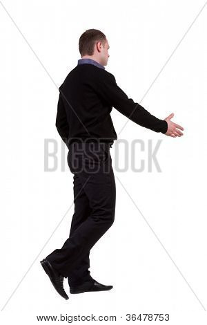 businessman in the movement reaches out to shake hands. Rear view people collection. backside view of person. Isolated over white background.