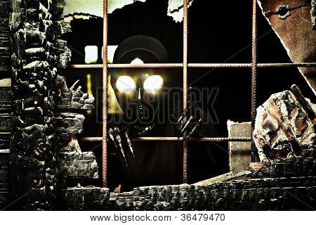 Scary alien creature in an abandoned house. Halloween, horror.