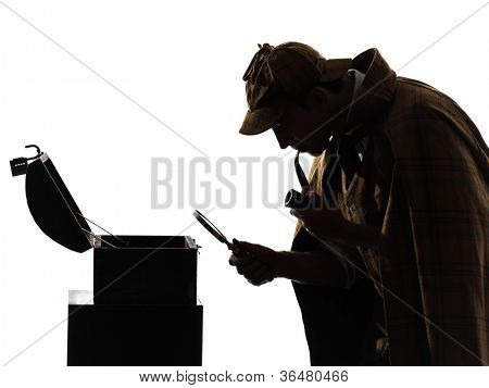 sherlock holmes looking at open safe silhouette in studio on white background