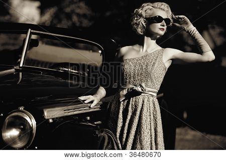 Woman near a retro car outdoors