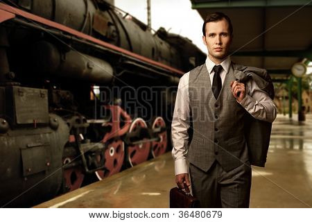 Man with a briefcase on a train station