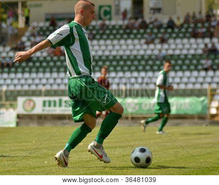 KAPOSVAR, HUNGARY - AUGUST 26: Patrik Bojte in action at a Hungarian Championship II. soccer game Kaposvar II. (green) vs. Paks II. (claret) August 26, 2012 in Kaposvar, Hungary.