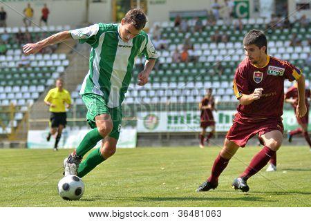 KAPOSVAR, HUNGARY - AUGUST 26: Krisztian Kircher (in green) in action at a Hungarian Championship II. soccer game Kaposvar II. (green) vs. Paks II. (claret) August 26, 2012 in Kaposvar, Hungary.