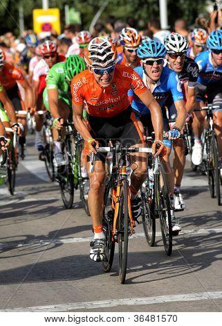 BARCELONA - AUG, 26: Euskaltel-Euskadi spanish cyclist Igor Anton rides with the pack during the Vuelta Ciclista a Espana cycling race in Barcelona on August 26, 2012