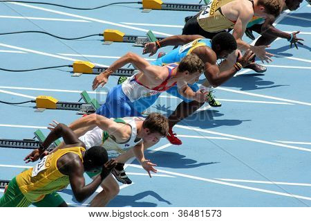 BARCELONA - JULY, 10: Competitors on start of 110m men hurdles during the 20th World Junior Athletics Championships at the Olympic Stadium on July 10, 2012 in Barcelona, Spain