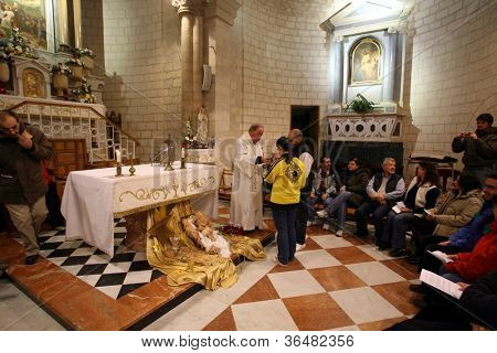 CANA , ISRAEL - DECEMBER 30: The Church of Jesus' first miracle. Couples from all over the world come to renew their wedding vows, Cana, Israel on December 30, 2007.