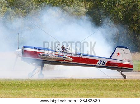 PILSEN, CZECH REPUBLIC - AUGUST 25: The Yakovlev Yak-55 aerobatic aircraft piloting famous Czech aerobatic pilot Karel Kuthan, Pilsen Aeronautical Days on August 25, 2012 in Pilsen, Czech Republic.
