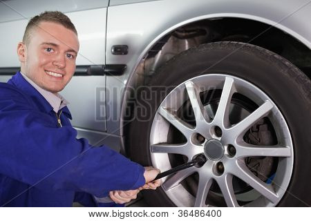 Mechanic holding a wrench in a garage