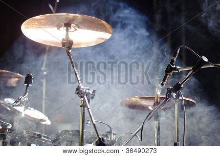 cymbals set in light of searchlights