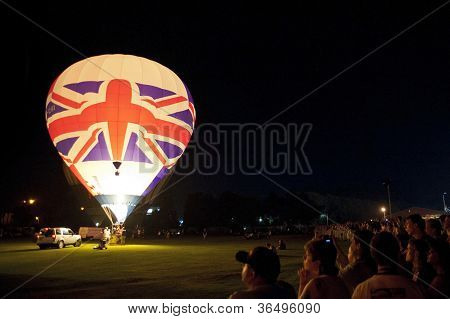NORTHAMPTON, ENGLAND - AUGUST 18: Hot Air Balloon with british flag doing night time show at the Northampton Balloon Festival, on August 18, 2012 in Northampton, England.