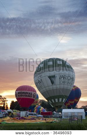 NORTHAMPTON, ENGLAND - AUGUST 18: Hot Air Balloons launching in the early morning at the Northampton Balloon Festival, on August 18, 2012 in Northampton, England.
