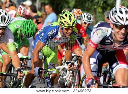 BARCELONA - AUG 26: Liquigas Cannondale Italian cyclist Cristiano Salerno(C) rides with the pack during the Vuelta Ciclista a Espana cycling race in Barcelona on August 26, 2012