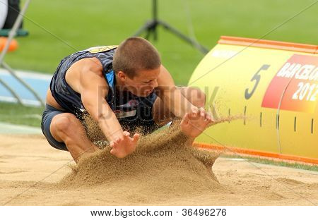 BARCELONA - JULY 10: Gunnar Nixon of USA during Long Jump Decathlon event of the 20th World Junior Athletics Championships at the Olympic Stadium on July 10, 2012 in Barcelona, Spain
