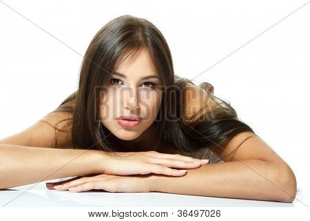 Beautiful girl lying down and happy smiling. Isolated on white background