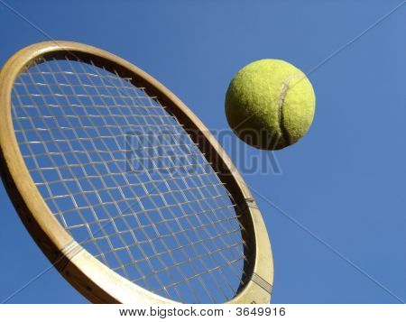 Tennis Ball And Wooden Racket