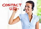picture of telemarketing  - Beautiful woman writing Contact - JPG