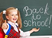 picture of knapsack  - Happy child with backpack writting on blackboard - JPG