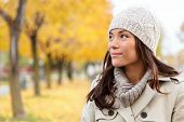 stock photo of trench coat  - Fall woman portrait of woman looking sideways smiling serene - JPG