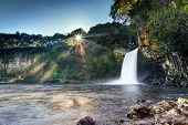 Scenic view of sunrise on Bassin la Paix waterfall - Reunion Island.