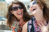 stock photo of homosexual  - Portrait of two happy young beautiful women - JPG