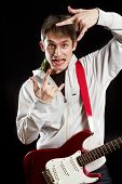 stock photo of stratocaster  - Man with red electric guitar - JPG