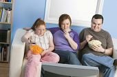 stock photo of obese children  - Family Watching Television - JPG