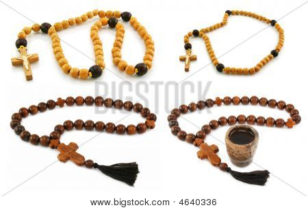 Set Of Wooden Rosary And Crosses Isolated