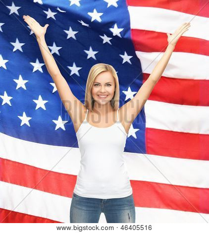 picture of happy woman in blank white t-shirt over american flag