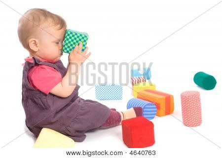 Baby Palying mit Spielzeug Blöcke