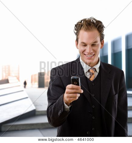 Happy Businessman With Cellphone