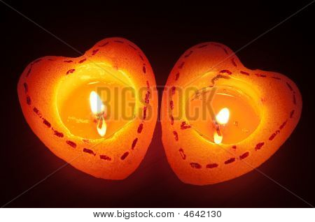Two Burning Heart Candles