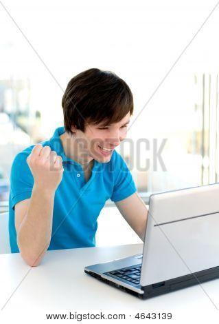 Man Using Laptop, Clenching Fist