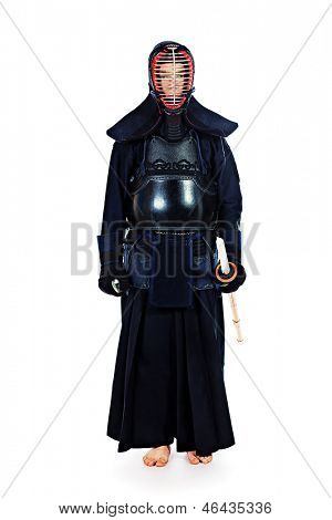 Kendo fighter posing at studio. Isolated over white.