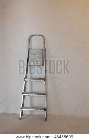 Stepladder Near The Plaster Wall