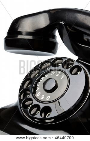 an old, old landline telephone. phone on white background.